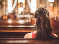 Woman visiting a christian church